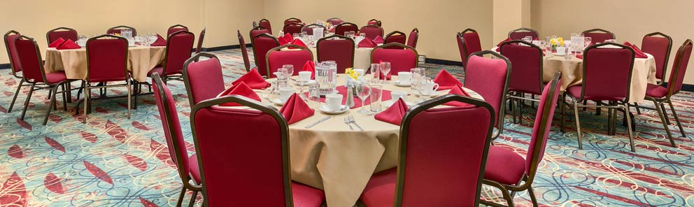 Round table set up for an event in the ballroom at the Days Inn Stephenville hotel