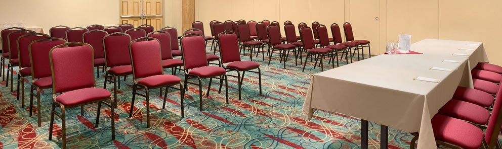 A spacious meeting room with rows of chairs at the Days Inn Stephenville hotel located near the Stephenville airport