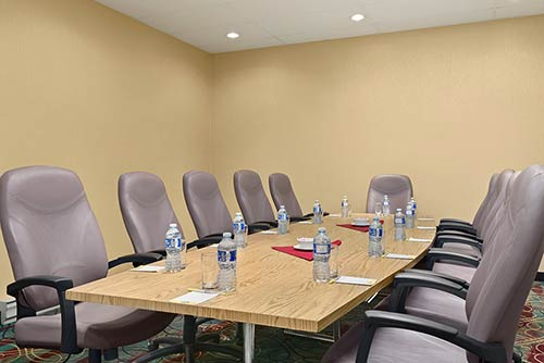 A large boardroom with premium rolling chairs, a large table & more at the Days Inn Stephenville hotel