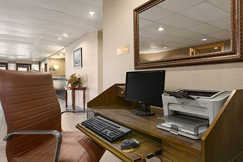 The business center at the Days Inn Stephenville hotel featuring a computer and printer