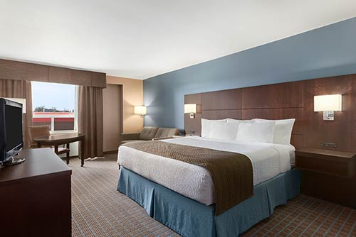 A spacious executive suite at the Days Inn Stephenville hotel located near the Stephenville Theatre Festival